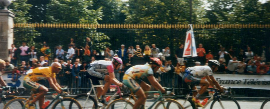 Paris, France - August 2, 1998: Vintage shot of the final race of Tour de France in 1998 at the Champs Elysees in Paris, with the winner Marco Pantani riding in yellow shirt.