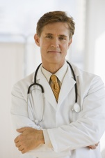 Doctor with crossed arms looking at camera