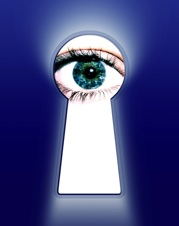 blue eye looking thru a keyhole