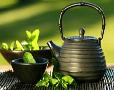 Black asian teapot with mint tea